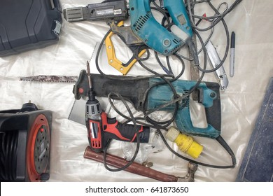 Collection of used power tools, DIY repair equipment.