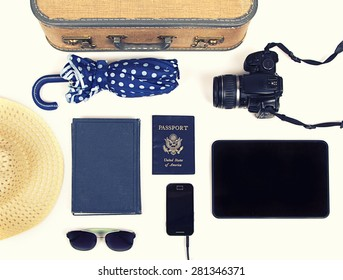 Collection of vacation travel items with a vintage filter