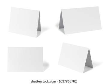 collection of various  blank folded leaflet or a desktop calendar white paper on white background. each one is shot separately