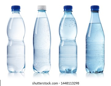 Collection of various bottles of water isolated on white background