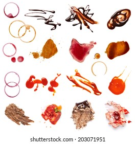 collection of various coffee, wine, ketchup, chocolate and cake stains on white background. each one is shot separately