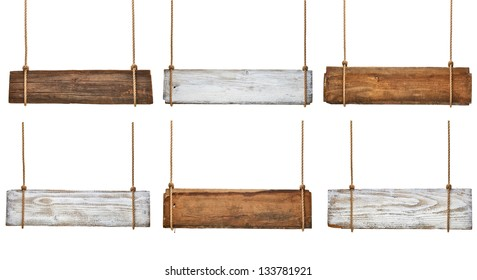 collection of various empty wooden signs hanging on a rope on white background. each one is shot separately