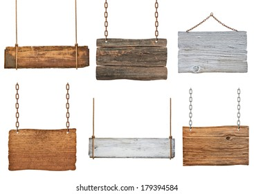 collection of various empty wooden signs hanging on a rope and chain on white background. each one is shot separately