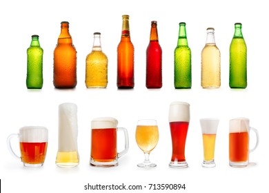 Collection of various full beer bottles and glasses. Isolated on white
