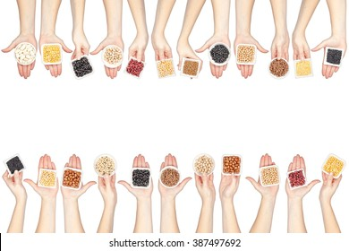 collection of various legumes in a hands isolated on white background