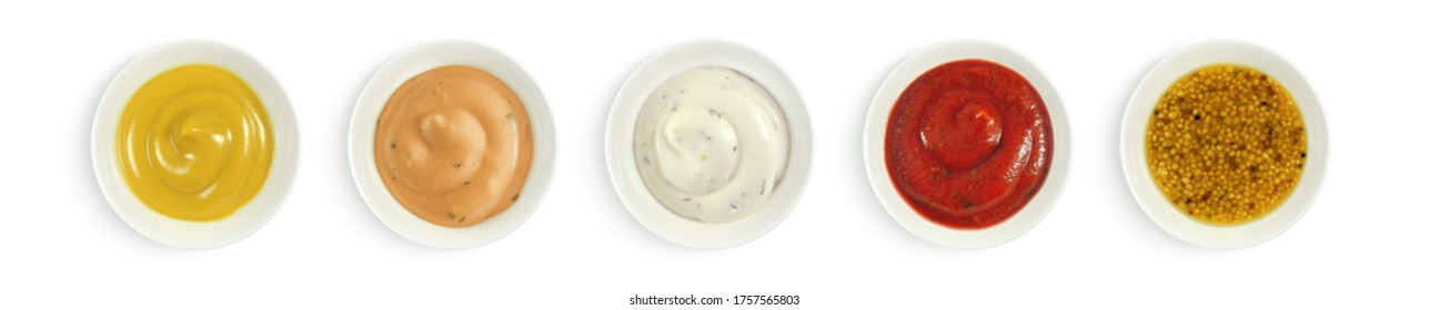 Collection of various sauces in white ceramic bowl top view. Mustard, burger sauce, tartar, ketchup isolated on white background.