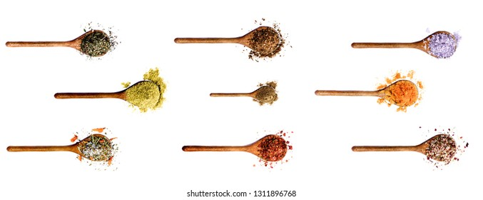 Collection of Various Spices in Wooden Spoons: Thyme, Cumin Powder, Salt with Petals, Dried Paprika, Zira, Salt with Cayenne Pepper, Kosher Salt, Curry Powder and Salt with Chili