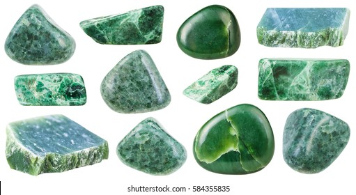 collection of various tumbled green jade mineral stones (nephrite and jadeite) isolated on white background