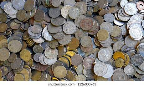 Collection of various types of new old ancient Indian rupee coins piled photograph image isolated macro close up