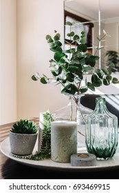 Collection of vases with greenery on a styled dining table