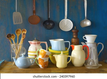 collection of vintage kitchenware, blue background