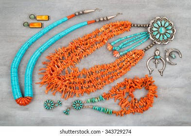 A collection of Vintage Native American Jewelry made of turquoise, silver and branch coral.
