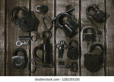 Collection of vintage padlocks and keys on wooden background. Vintage style, retro items