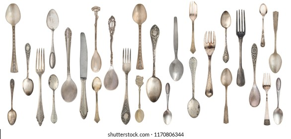 Collection vintage spoons, forks and knife isolated on a white background. Retro silverware.