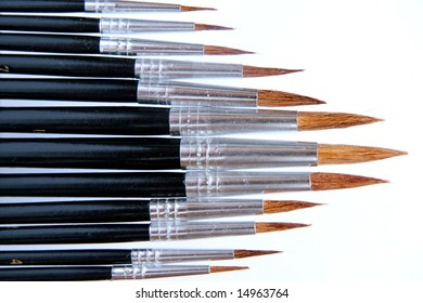Collection of watercolor brushes against white background