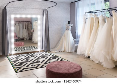 Collection of wedding dresses in the shop. Wedding salon interi