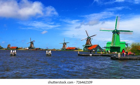A collection of well-preserved historic windmills and houses in Zaanse Schans, Netherlands