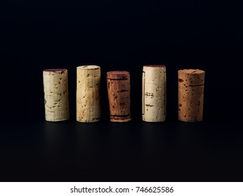 collection of wine corks on black background