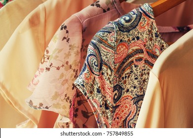 collection of women's clothes hanging on rack for sale
