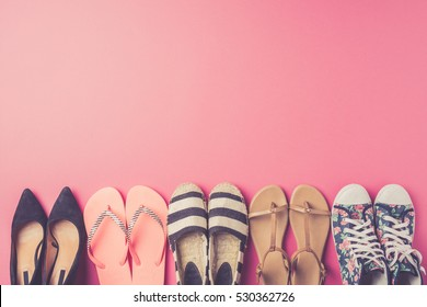 Collection of women's shoes on pink background