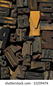 collection of wood type blocks with an emphasis on an exclamation point