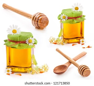 Collection of a wooden honey dipper and Honey in glass jar with flowers isolated on white background