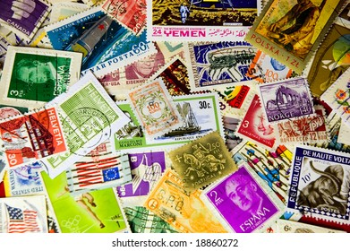 A collection of world stamps in a pile.