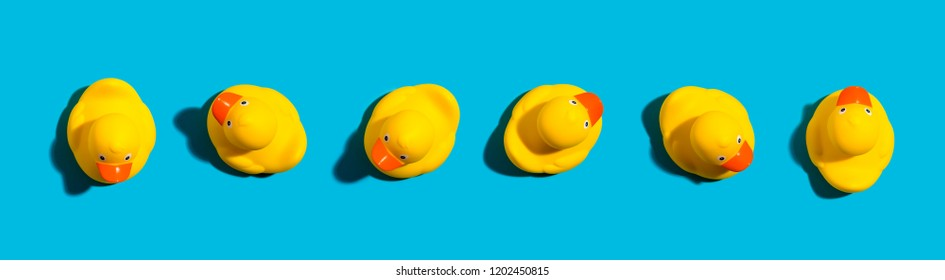 Collection of yellow rubber ducks on a blue background