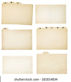 Collection of yellowing tabbed index cards and two faded, lined index cards without tabs.  Each card or group is isolated on white with clipping path.