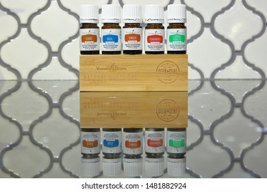 A collection of Young Living Essential Oils from the Vitality Line on black granite - San Antonio, Texas, USA - August 17, 2019