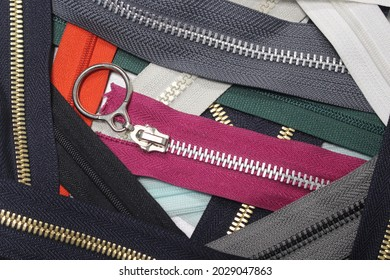 Collection of zippers of different colors and variants in the textile industry
