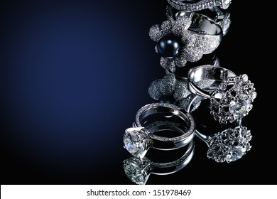 Collections of rings with diamond isolated on black background