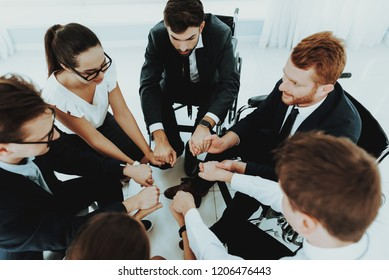 Collective Work. Group Disabled Worker. Workers with Disabilities. Business Meeting. Business Suits. Work Concept. Mans in Wheelchair. Disabled Donate Hands. Collective Handshake. Group Disabled.