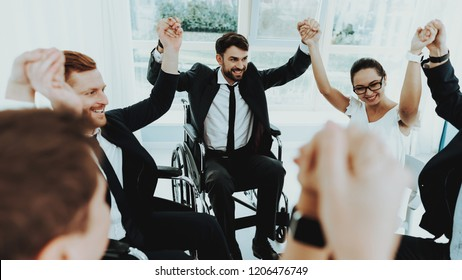 Collective Work. Group Disabled Worker. Workers with Disabilities. Business Meeting. Business Suits. Disabled Raise Hands. Mans in Wheelchair. Full-fledged People and Disabled. Collective Handshake.