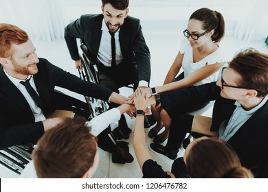 Collective Work. Group Disabled Worker. Workers with Disabilities. Business Meeting. Business Suits. Discuss Work Concept. Mans in Wheelchair. Full-fledged People and Disabled. Collective Handshake.