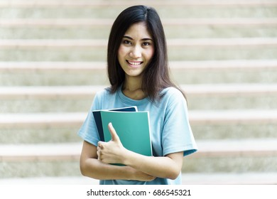College asian student female sitting on staircase