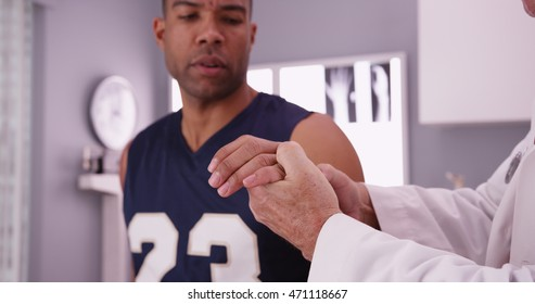 College basketball player with sports injury being examined by doctor.