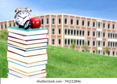 college campus as blurry background behind decoration of book and accessory