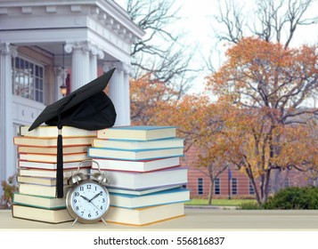 college campus and book for education concept