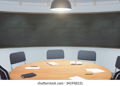 College classroom with round wooden table and blackboard 3D Render