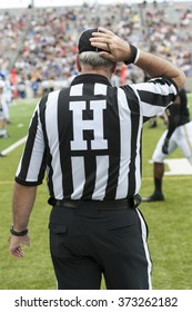 College Football referees and judges manage a game