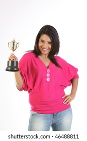 college girl holding the winning gold trophy