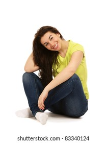 A college girl sitting on floor isolated on white