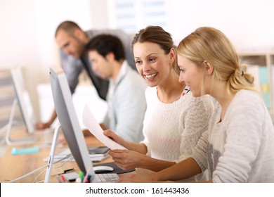 College girls working in front of desktop