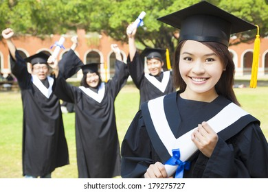 college graduate with happy classmates