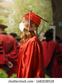 A college graduate is wearing a red robe and cape with a surgical facial mask for the coronavirus fear on the class of 2020.