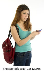 College / High School student with backpack texting cellular phone