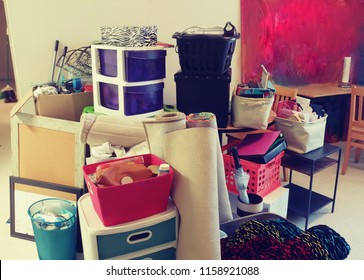 College moving day, pile of stuff, pink and teal.