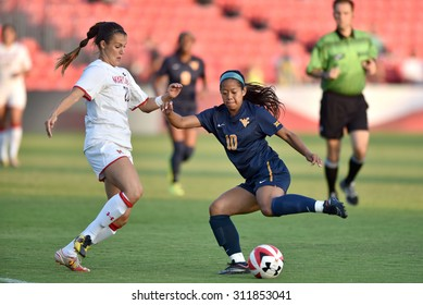 COLLEGE PARK, MD - AUGUST 28: West Virginia Carla Portillo (10) tries to avoid a Terp defender during the NCAA women's soccer game August 28, 2015 in College Park, MD.