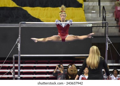 COLLEGE PARK, MD - JANUARY 9: Maryland gymnast Katy Dodds performs on the uneven bars during a meet January 9, 2015 in College Park, MD.